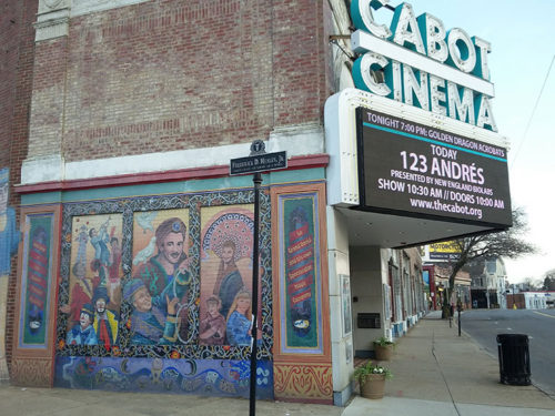 The mural on the side of The Cabot Theater in the Beverly Arts District features Le Grand David and His Own Spectacular Magic Company.