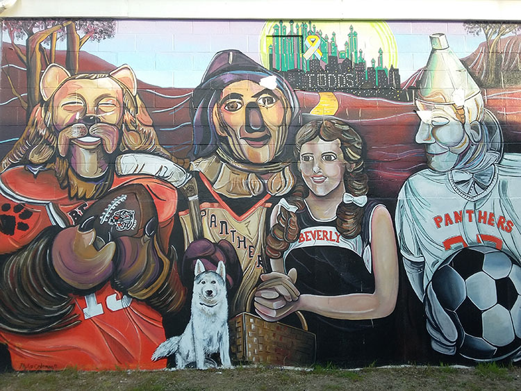 Todd's Sporting Goods, in Beverly MA - a mural on the outside of the building featuring Dorothy, Cowardly Lion, Tin Woodman and Toto.