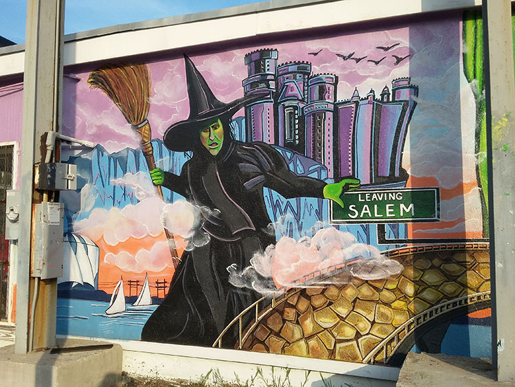 Todd's Sporting Goods, in Beverly MA has a Wizard of Oz series of murals on the outside of the building. Here we see the Wicked Witch of the West leaving Salem and heading for Beverly!